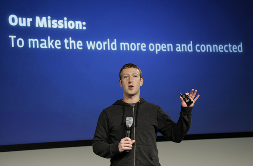 FILE- In this Thursday, March 20, photo, Facebook CEO Mark Zuckerberg speaks at Facebook headquarters in Menlo Park, Calif. A research firm expects Facebook's mobile ad revenue to soar this year, hitting nearly $1 billion a year after the company started to splice ads into its users' mobile phones and tablets. (AP Photo/Jeff Chiu)