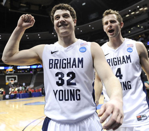 BYU's Jimmer Fredette, left, and Emery Jackson celebrate as they walk off the court after BYU defeated Gonzaga 89-67 in a Southeast regional third round NCAA tournament college basketball game, Saturday, March 19, 2011, in Denver. (AP Photo/Jack Dempsey)