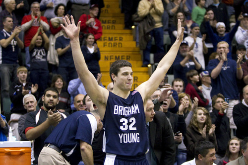 Jaren Wilkey  |  Brigham Young University  Jimmer Fredette responds to a standing ovation at his hometown game in Glens Falls, N.Y., on Dec. 8, 2010.