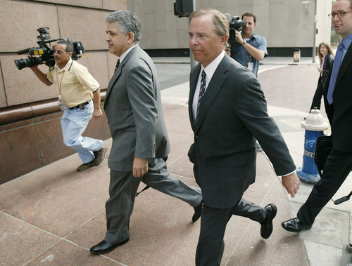 (AP Photo/David J. Phillip) Former Enron CEO Jeffrey Skilling, center, was convicted in 2006 on 19 counts of conspiracy, securities fraud, insider trading and lying to auditors for his role in the downfall of Houston-based Enron.