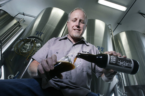 """Scott Sommerdorf      The Salt Lake Tribune Epic co-founder David Cole pours a """"Santa Cruz Brown"""" on Thursday, Jan. 31, 2013, at the Epic brewery in Salt Lake City. Epic beers sells its freshly brewed and bottled beer on-site, as well as in state liquor stores and in restaurants and bars. It is one of 18 breweries in Utah, where many of the business are booming."""