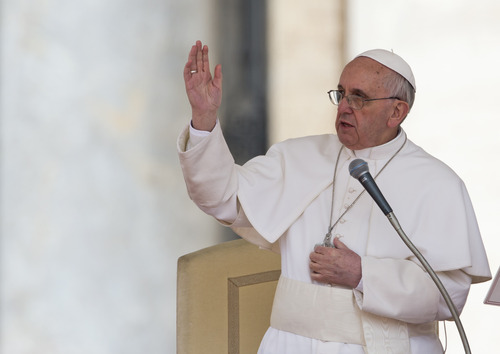 Pope Francis delivers his blessing during  his weekly general audience in St. Peter square at the Vatican Wednesday, April 3, 2013. (AP Photo/Alessandra Tarantino)