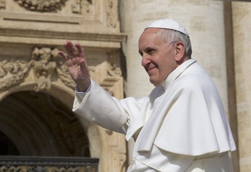 Pope Francis leaves after his weekly general audience in St. Peter square at the Vatican Wednesday, April 3, 2013. (AP Photo/Alessandra Tarantino)