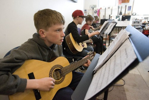 Paul Fraughton  |  The Salt Lake Tribune Eddie Arsuffi learns to play guitar in the music room at The Salt Lake Arts Academy.