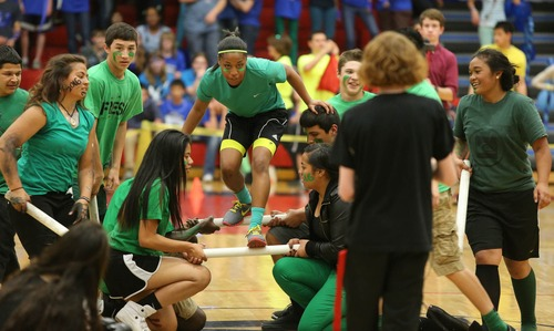 Paul Fraughton  |   Salt Lake Tribune West High School freshman Jayda Nance, center,  competes with her team in a movable staircase  race, one of the contests at the Spirit Bowl pitting teams from the freshman, sophomore, junior,  and senior classes  against one another.  Friday, March 29, 2013