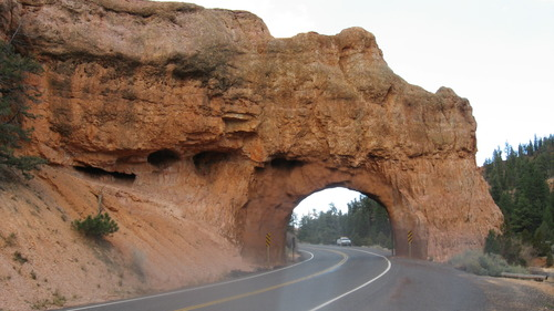 This rock arch tunnel, constructed near Bryce Canyon National Park in Red Canyon along Utah Highway 12, is a popular tourist photo opportunity. (Courtesy UDOT)