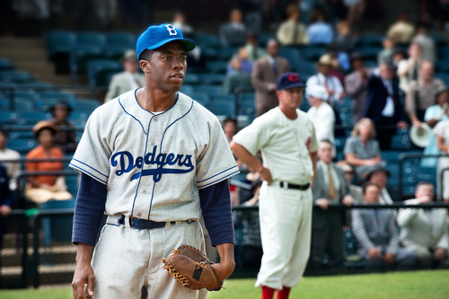 "This film image released by Warner Bros. Pictures shows Chadwick Boseman as Jackie Robinson in a scene from ""42,"" by writer-director Brian Helgeland. Remembering Robinson's accomplishments is more important than ever, say people involved with ""42"" and baseball historians alike. And because he was such an inspiring cultural figure, it's more important than ever to get his story right. (AP Photo/Warner Bros. Pictures, D. Stevens)"