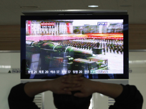 A South Korean man who is waiting to head to the North Korean city of Kaesong, watches a news program airing file footage of a North Korean rocket displayed during a military parade at the customs, immigration and quarantine office in Paju, South Korea, near the border village of Panmunjom, Thursday, April 4, 2013. North Korea's vow to restart its mothballed nuclear facilities raises fears about assembly lines churning out fuel for a fearsome arsenal of nuclear-tipped missiles. But it may actually be a sign that Pyongyang needs a lot more bomb fuel to back up its nuclear threats. (AP Photo/Ahn Young-joon)