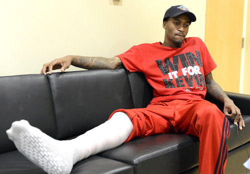 Louisville basketball player Kevin Ware answers questions during an interview Wednesday April 3, 2013, at the KFC Yum! Center practice facility in Louisville, Ky. Ware was released from an Indianapolis hospital Tuesday, two days after millions watched him break his right leg on a horrifying play trying to block a shot during an NCAA college basketball regional championship game against Duke.  (AP Photo/Timothy D. Easley)