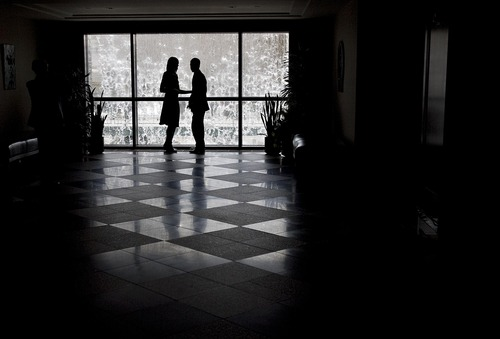 Djamila Grossman  |  The Salt Lake Tribune  A couple stand in front of a window in the LDS Conference Center for the 181st Annual General Conference in April 2011. Mormon couples frequently go on dates to conference sessions.