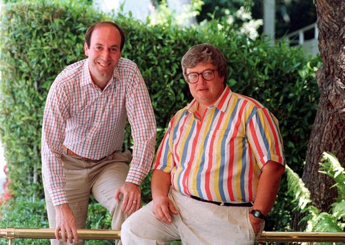 FILE - This 1986 photo shows Roger Ebert, right, and Gene Siskel in Los Angeles. Ebert, the nation's best-known film reviewer who with fellow critic Siskel created the template for succinct thumbs-up or thumbs-down movie reviews, died Thursday, April 4, 2013. He was 70.  (AP Photo/Douglas C. Pizac, File)