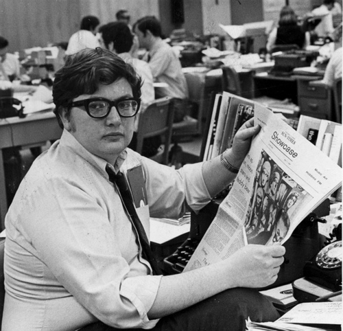 This 1969 photo shows Chicago Sun-Times movie critic Roger Ebert in the newsroom of the paper in Chicago. Ebert, the most famous and popular film reviewer of his time who became the first journalist to win a Pulitzer Prize for movie criticism and, on his long-running TV program, wielded the nation's most influential thumb, died Thursday, April 4, 2013. He was 70. (AP Photo/Chicago Sun-Times, Bob Kotalik)