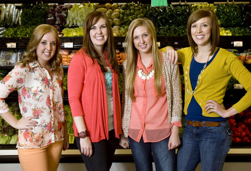 "Kim Raff  |  The Salt Lake Tribune (from left) Lauren Adamson, Camille Beckstrand, Kendra Adamson and Elyse Ellis, are four of the six Utah sisters that published the cookbook ""Six Sisters' Stuff"" and are challenging readers to eat dinners as a family, are photographed at Smith's Food and Drug in Farmington on March 11, 2013."