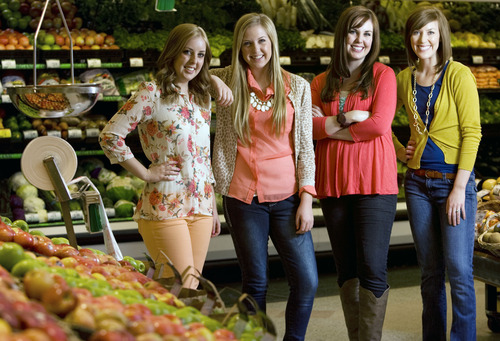 "Kim Raff  |  The Salt Lake Tribune (from left) Lauren Adamson, Kendra Adamson, Camille Beckstrand, and Elyse Ellis, are four of the six Utah sisters that published the cookbook ""Six Sisters' Stuff"" and are challenging readers to eat dinners as a family, are photographed at Smith's Food and Drug in Farmington on March 11, 2013."