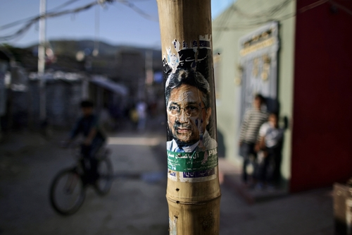 A poster showing the image of former Pakistani President Pervez Musharraf is placed on a pole in a neighborhood in Islamabad, Pakistan, Friday, April 5, 2013. Pakistani officials have provoked both laughter and criticism in recent days as they vetted potential candidates in the country's upcoming national elections with questions that veered between the controversial and the bizarre. (AP Photo/Muhammed Muheisen)