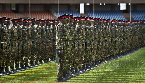 Members of the Kenyan military parade as they practice ahead of the presidential inauguration which is due to take place on Tuesday, at the Kasarani stadium near Nairobi, Kenya, Friday, April 5, 2013. Kenya's Supreme Court last week upheld the election of Uhuru Kenyatta as the country's next president and the loser Raila Odinga accepted that verdict, ending an election season that riveted the nation with fears of a repeat of the 2007-08 postelection violence. (AP Photo/Ben Curtis)