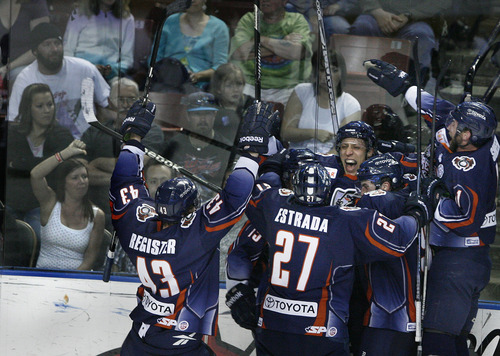 Scott Sommerdorf      The Salt Lake Tribune Grizzlies fans react as Ontatio celebrates their game winning goal by Jake Hauswirth, center. The Utah Grizzles lost 2-1 in overtime to the Ontario Reign in Game 3 of the ECHL playoffs at 1-1 at the Maverick Center, Friday, April 5, 2013. The Grizzlies had a 1-0 lead with 29 seconds left in regulation when Nick Ebert scored for the Reign to tie it up and force OT.
