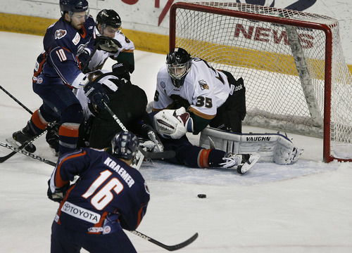 Scott Sommerdorf      The Salt Lake Tribune Utah Grizzlies goalie Shane Owen keeps his eye on the puck as Ontario Reign F Kyle Kraemer (#16) looks to rush in on the rebound during first period play. The Grizzlies led 1-0 after one period on forward Chris Donovan's penalty shot goal in Game 3 of the ECHL playoffs at the Maverick Center, Friday, April 5, 2013.