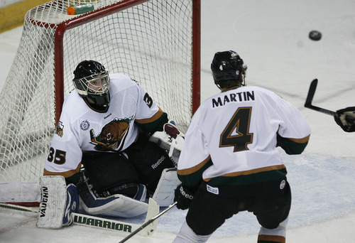Scott Sommerdorf      The Salt Lake Tribune Grizzlies goalie Shane Owen keeps his eyes on a puck flying near the goal mouth during second periood play. After a scoreless second period, the Utah Grizzlies led the Ontario Reign 1-0 on forward Chris Donovan's first period penalty shot goal in Game 3 of the ECHL playoffs at the Maverick Center, Friday, April 5, 2013.
