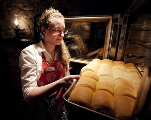 Steve Griffin | The Salt Lake Tribune   Sarah Birth removes a rack of rolls at the Lion House in Salt Lake City, Utah Wednesday March 20, 2013.