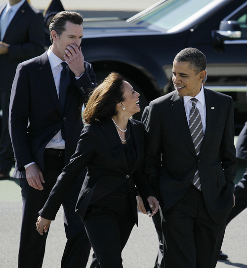 "FILE -- in this Feb. 16, 2012 file photo President Barack Obama walks with California Attorney General Kamala Harris, center, and  California Lt. Gov. Gavin Newsom, after arriving at San Francisco International Airport in San Francisco. Obama praised California's attorney general for more than her smarts and toughness at a Democratic Party event Thursday, April 4, 2013. The president also commended Harris for being ""the best-looking attorney general"" during a Democratic fundraising lunch in the Silicon Valley. (AP Photo/Eric Risberg, File)"