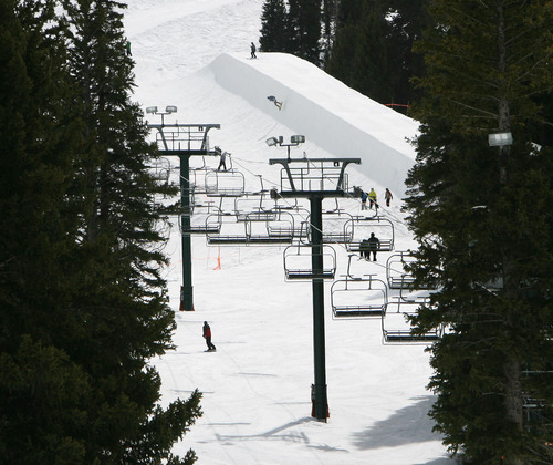 Steve Griffin | The Salt Lake Tribune  Skiers and boarders enjoy spring skiing at Brighton on Thursday April 4, 2013. But new reports are warning of a grim outlook for Utah's snowpack, runoff and water supply this year.