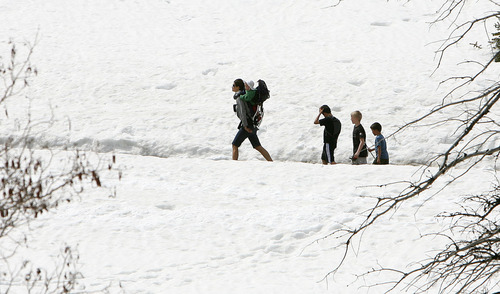 Steve Griffin | The Salt Lake Tribune  A family enjoys a hike in Big Cottonwood Canyon in Salt Lake City on Thursday April 4, 2013. But new reports are warning of a grim outlook for Utah's snowpack, runoff and water supply this year.