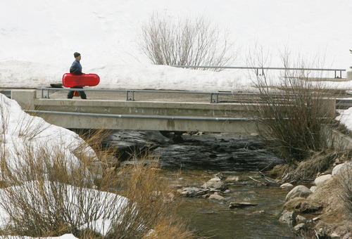 Steve Griffin | The Salt Lake Tribune  Sledders still have plenty of snow to enjoy a few more runs this spring in Big Cottonwood Canyon as seen on Thursday April 4, 2013. But new reports are warning of a grim outlook for Utah's snowpack, runoff and water supply this year.
