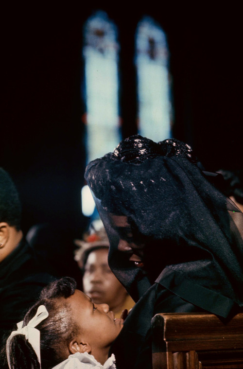FILE - Coretta Scott King is shown with her daughter, Bernice, during the funeral of her husband, civil rights leader Dr. Martin Luther King Jr., at the Ebenezer Baptist Church in Atlanta, Ga.,  April 9, 1968.  The civil rights leader was standing on the balcony of the Lorraine Motel when he was killed by a rifle bullet on April 4, 1968. James Earl Ray pleaded guilty to the killing and was sentenced to 99 years in prison. He died in prison in 1998. (AP Photo)