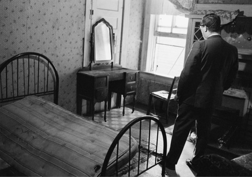 FILE - A news reporter stands in the room rented by the assassin who shot Dr. Martin Luther King Jr., in Memphis, Tenn., April 5, 1968.   The civil rights leader was standing on the balcony of the Lorraine Motel when he was killed by a rifle bullet on April 4, 1968. James Earl Ray pleaded guilty to the killing and was sentenced to 99 years in prison. He died in prison in 1998.  (AP Photo)