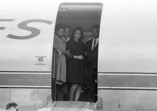 FILE - Coretta Scott King, center, widow of slain civil rights leader Dr. Martin Luther King, Jr., is comforted in the doorway of an airliner in Memphis, Tenn., April 5, 1968, as her husband's body is brought up the ramp.   The civil rights leader was standing on the balcony of the Lorraine Motel when he was killed by a rifle bullet on April 4, 1968. James Earl Ray pleaded guilty to the killing and was sentenced to 99 years in prison. He died in prison in 1998.  (AP Photo)
