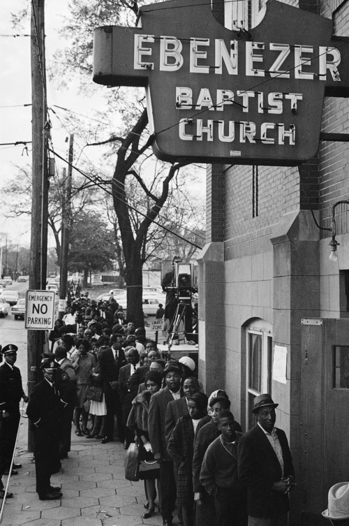 FILE - Mourners waiting to view the body of Dr. Martin Luther King Jr. line up outside the Ebenezer Baptist Church in Atlanta just after dawn April 9, 1968. Many had dept a night-long vigil.  The civil rights leader was standing on the balcony of the Lorraine Motel when he was killed by a rifle bullet on April 4, 1968. James Earl Ray pleaded guilty to the killing and was sentenced to 99 years in prison. He died in prison in 1998.(AP Photo)