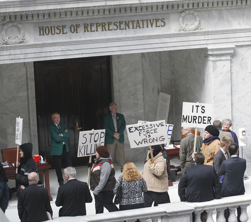 Al Hartmann  |  The Salt Lake Tribune Friends, family and citizens demonstrate in the state capitol in front of the House of Representatives Monday March 4 against what they believe was excessive force by police in the deaths of Danielle Willard, Corey Kanosh and Kelly Simmons.