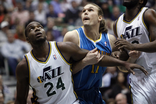 Chris Detrick  |  The Salt Lake Tribune Utah Jazz power forward Paul Millsap (24) and New Orleans Hornets power forward Lou Amundson (17) during the game at EnergySolutions Arena Friday April 5, 2013. Utah is winning the game 45-43 at halftime.