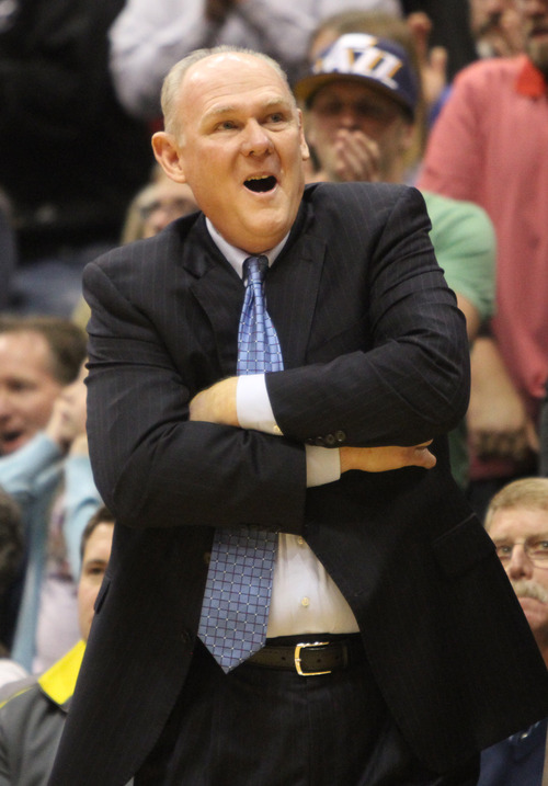 Rick Egan  | The Salt Lake Tribune   Denver Nuggets head coach George Karl reacts to a call by the referee,  in NBA action,  Utah defeated Denver 105-103 in Salt Lake City, Monday, November 26, 2012.