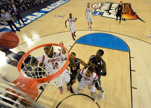 Louisville's Gorgui Dieng (10) grabs a rebound during the first half of the NCAA Final Four tournament college basketball semifinal game against Wichita State Saturday, April 6, 2013, in Atlanta. (AP Photo/NCAA Photos, Chris Steppig)