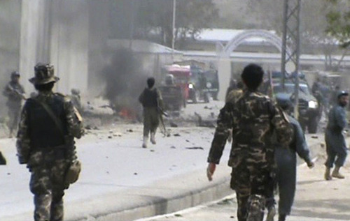 This image made from AP video shows Afghan National Army soldiers rushing to the scene moments after a car bomb exploded in front the PRT, Provincial Reconstruction Team, in Qalat, Zabul province, southern Afghanistan, Saturday, April 6, 2013. Three U.S.  soldiers, two U.S. civilians and a doctor were killed when a suicide bomber detonated a car full of explosives just as a convoy with the international military coalition drove past another convoy of vehicles carrying the governor of Zabul province. (AP Photo via AP video)