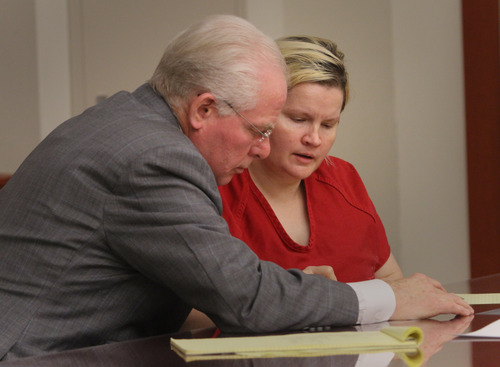Rick Egan  | The Salt Lake Tribune  Janeen Lundberg speaks with her attorney, John Walsh, during her preliminary hearing on Nov. 30, 2012. While there has been no allegation of deficient defense in Lundberg's case, a Utah committee is reviewing the state's patchwork system of public defenders to determine what improvements can be made.