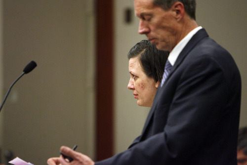 Francisco Kjolseth  |  The Salt Lake Tribune Sandra Chotia-Thompson enters Judge Ann Boyden's courtroom at the Matheson Courthouse on Feb. 28, 2013, for a pretrial hearing where her attorney Michael Peterson asked for more time. While there has been no allegation of deficient defense in Chotia-Thompson's case, a Utah committee is reviewing the state's patchwork system of public defenders to determine what improvements can be made.
