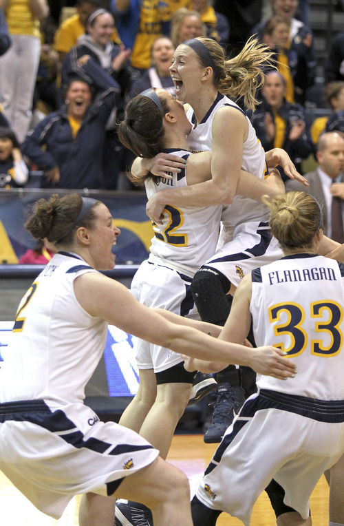 Drexel's Hollie Mershon, second from right, leaps into the arms of teammate Meghan Creighton after Drexel defeated Utah 46-43 in the championship game of the Women's NIT basketball tournament Saturday, April 6, 2013, in Philadelphia. Mershon scored the winning basket and was named the most valuable player of the tournament. (AP Photo/Philadelphia Inquirer, Charles Fox)  TV OUT  MAGS OUT