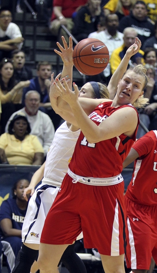 Utah's Taryn Wicijowski loses the ball as she gets tangled up with Drexel players in the second half of their NCAA women's college WNIT championship tournament game, Saturday, April 6, 2013, in Philadelphia. Drexel defeated Utah 46-43. (AP Photo/ Philadelphia Inquirer, Charles Fox) PHIX OUT; TV OUT; NEWARK OUT. MAGAZINES OUT.