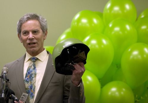 Kim Raff  |  The Salt Lake Tribune Salt Lake City Mayor Ralph Becker holds up a bike helmet while speaking at the launch event for the GREENbike SLC bicycle-sharing project at the Wells Fargo building in Salt Lake City on Monday April 8, 2013. The program is a partnership between Salt Lake City, the Downtown Alliance, the Salt Lake Chamber and SelectHealth. The program will start with 100 GREENbikes and 10 stations around downtown.