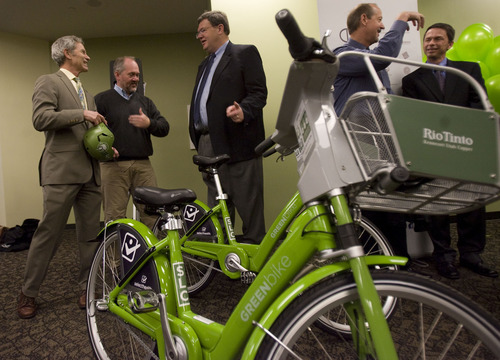 Kim Raff  |  The Salt Lake Tribune (from left) Salt Lake City Mayor Ralph Becker talks with Salt Lake City Council members Stan Penfold and Carlton Christensen during the launch event for the GREENbike SLC bicycle-sharing project at the Wells Fargo building in Salt Lake City on Monday April 8, 2013. The program is a partnership between Salt Lake City, the Downtown Alliance, the Salt Lake Chamber and SelectHealth. The program will start with 100 GREENbikes and 10 stations around downtown.