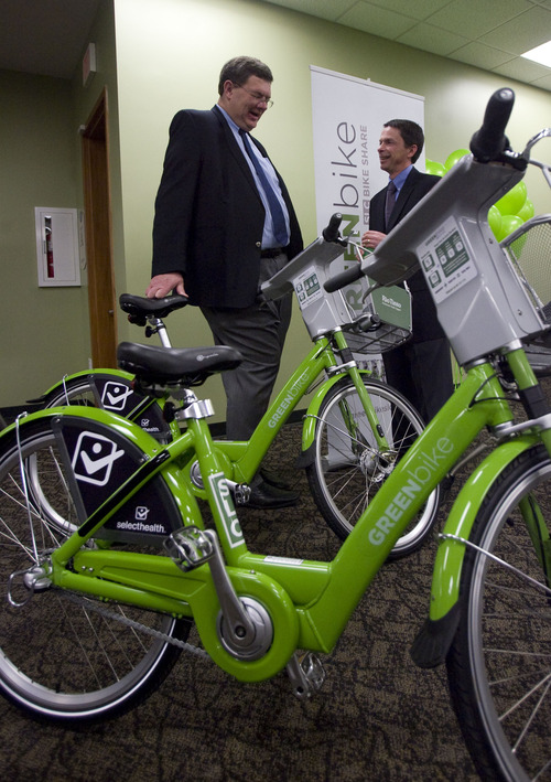Kim Raff  |  The Salt Lake Tribune (left) Salt Lake City Councilman Carlton Christensen talks with Kelly Sanders, president and CEO of Kennecott Utah Copper, during the launch event for the GREENbike SLC bicycle-sharing project at the Wells Fargo building in Salt Lake City on Monday April 8, 2013. The program is a partnership between Salt Lake City, the Downtown Alliance, the Salt Lake Chamber and SelectHealth. The program will start with 100 GREENbikes and 10 stations around downtown. Kennecott was a major sponsor of the program.