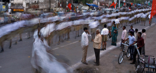 In this Sunday, April 7, 2013 photo, Hindu nationalist Rashtriya Swayamsevak Sangh (RSS) volunteers march as they mark the upcoming Vikram Samvat in Allahabad, India. Vikram Samvat, the beginning of a new year in the Hindu calendar, will begin April 11, 2013. (AP Photo/Rajesh Kumar Singh)