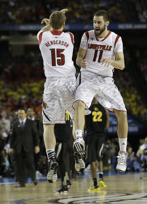 Louisville's Luke Hancock (11) and Louisville's Tim Henderson reacts to play against Wichita State during the second half of the NCAA Final Four tournament college basketball semifinal game Saturday, April 6, 2013, in Atlanta. (AP Photo/John Bazemore)