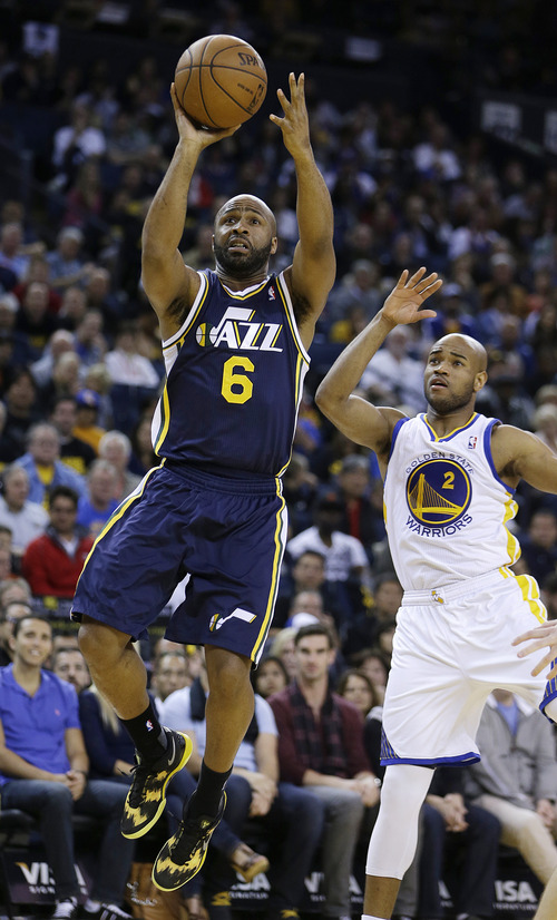 Utah Jazz's Jamaal Tinsley (6) shoots over Golden State Warriors' Jarrett Jack (2) during the first half of an NBA basketball game, Sunday, April 7, 2013, in Oakland, Calif. (AP Photo/Ben Margot)