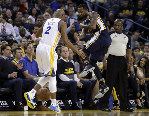 Utah Jazz' Mo Williams (5) throws the ball off Golden State Warriors' Jarrett Jack (2) before running out of bounds during the second half of an NBA basketball game Sunday, April 7, 2013, in Oakland, Calif. (AP Photo/Ben Margot)
