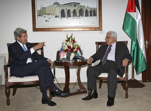 Palestinian President Mahmoud Abbas, right, meets with U.S. Secretary of State John Kerry in the West Bank city of Ramallah, Sunday April 7, 2013. (AP Photo / Mohamed Torokman)