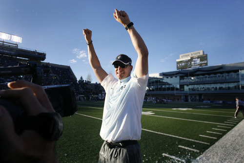 Scott Sommerdorf  |  The Salt Lake Tribune               Utah State Aggies head coach Gary Andersen celebrates winning the WAC championship on the sidelines in the closing seconds of their win over Idaho. Utah State defeated Idaho 45-9 in Logan, Saturday, November 24, 2012 to become champions of the WAC.